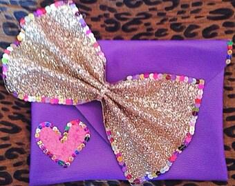 Purple embellished clutch bag
