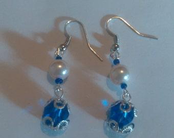 Blue and white plastic bead dangle earrings