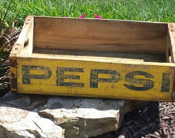 Vintage wooden Pepsi crate. Yellow color with blue lettering.