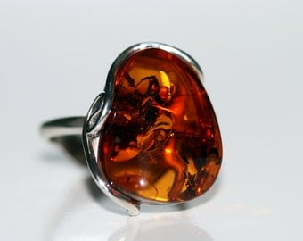 Baltic amber ring. Cognac piece of Baltic amber in sterling silver setting.