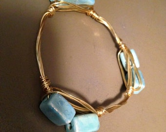 Blue blocks with gold wire