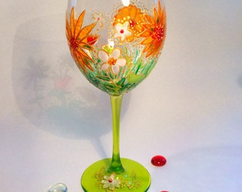 Hand painted wine glass. Daisy and flowers design. Spring party glass. Custom made in Germany. Weinglas. Handbemalt. Gift for her. Orange.