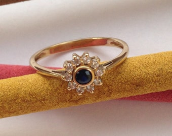 Gold Ring with Sapphires and zircons
