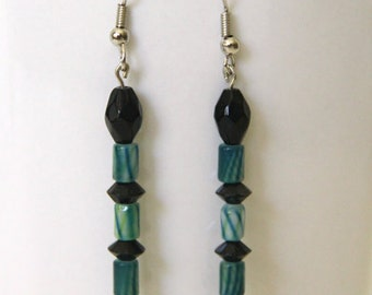 Green striped dangle earrings with black bead accents