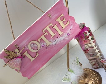 A beautiful bespoke name plaque, with the name of your choice