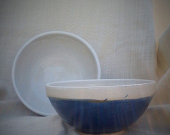 Set of two stacking serving bowls