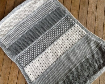Baby blanket in white and shades of gray