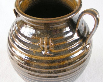 Brown hand thrown pottery vase