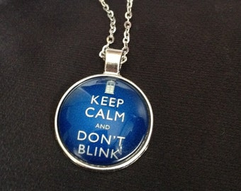 "Doctor Who inspred ""Don't Blink"" pendant necklace on silver tone chain"