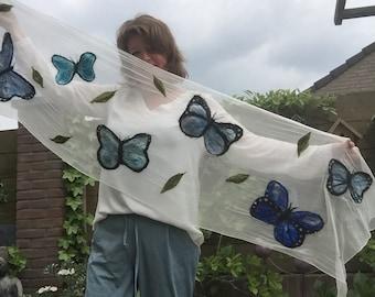 Nuno felted scarf of chiffon silk with blue butterflies of merino wool and silk fibers