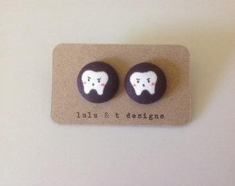 Tooth fabric covered button earrings pair