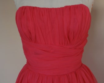 1950s hot pink party dress! nylon chiffon over taffeta strapless bustier style top with full 3 layer skirt, boning at bust