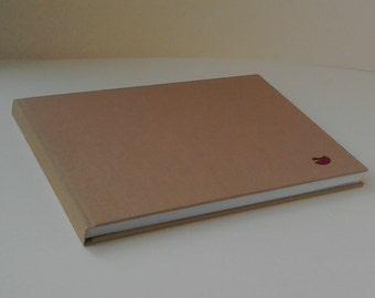A5 sketchbook landscape tissue interleaved.