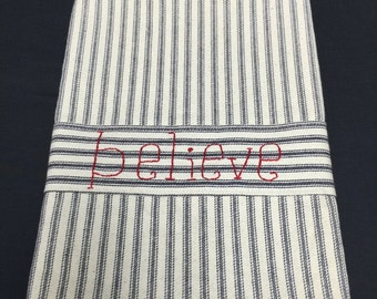 "Tea towels with hand embroidered ""Believe"", Peace"", & ""Joy"" strips."