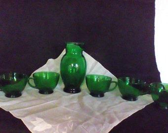 Green mugs and a vase