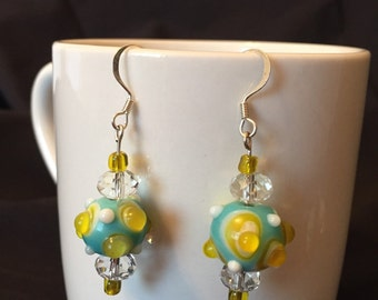 Yellow, teal, and white earrings