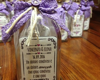 Wedding invitations in glass bottle