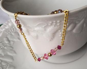 Pink Swarowski, gilt metal beads bracelet