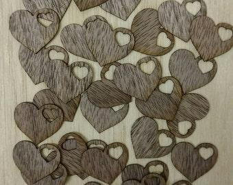 Wedding hearts scatter confetti cut from walnut veneer