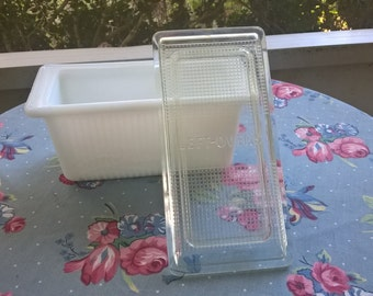 vintage milkglass leftovers container with clear plastic lid
