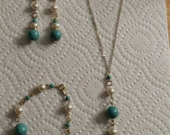 Necklace chain with blue and gold glass balls
