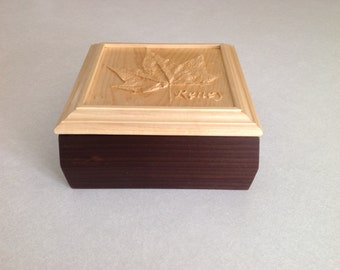 Handmade wooden box with maple leaf carving