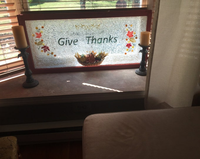 "Thanksgiving window...""Give Thanks""  displayed on window"