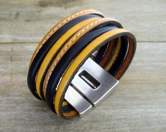 Male/female black leather bracelet and yellow mustard, magnetic clasp