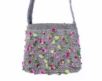 Knitted grey handbag with leather parts
