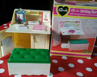Boxed original 1970s Sindy writing bureau with storage seat, secret compartments, diary, notebooks,  pencils, envelopes , ruler,