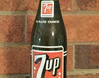 Vintage 1966 7-UP green bottle with drink.
