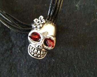 Silver skull with red Swarovski crystal eyes