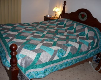 Queen quilt designed in grey's & aqua's, some silver  highlites