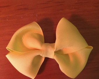 Yellow pinwheel bow