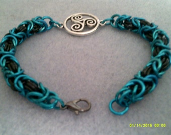 byzantine weave chainmaille bracelet with triskelion charm