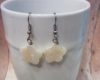 Small carved flower earrings