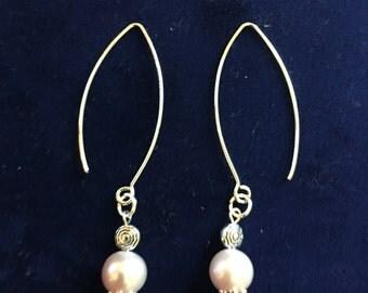 Dangling Pearl Oval earrings