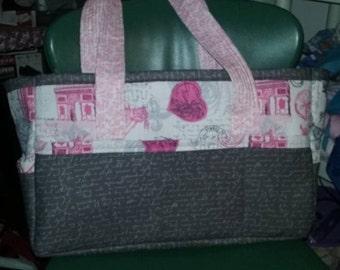 grey and pink diaper bag