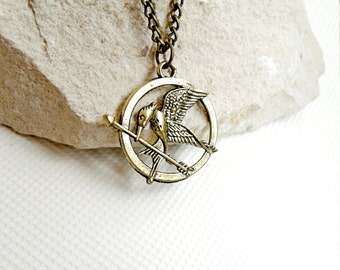 The hunger games pendant mockingjay logo, catching fire pendant Bird jay, film 1 hunger games sign, film fans accessories mockingjay locket