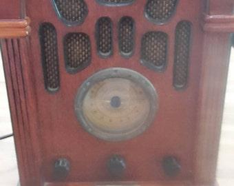 A vintage look radio-cassette recorder.