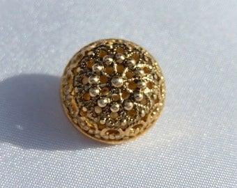 Rococo style button.