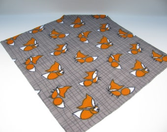 Doudou for child or baby, with images of Fox in orange, grey and white.