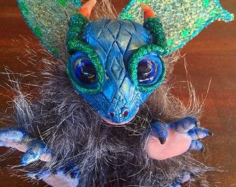Hand sculptured baby dragon