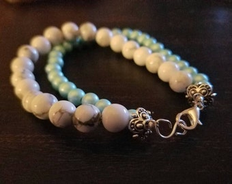 Multi Strand Bracelet with Pearlescent Blue and White and Black Swirled  Beads
