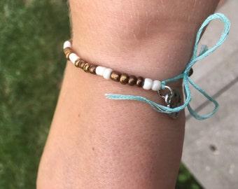 Antique Brass and white bracelet
