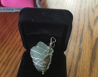 Sea glass with sea shell