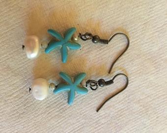 Starfish pearl earrings.