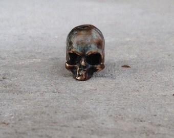 Bronze 2-eyed skull bead