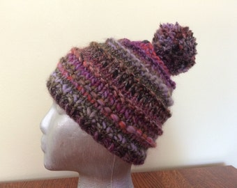 Multi-color knit hat with pompom