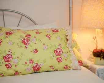 Roses on yellow chintz pillow shams with contrasting accents